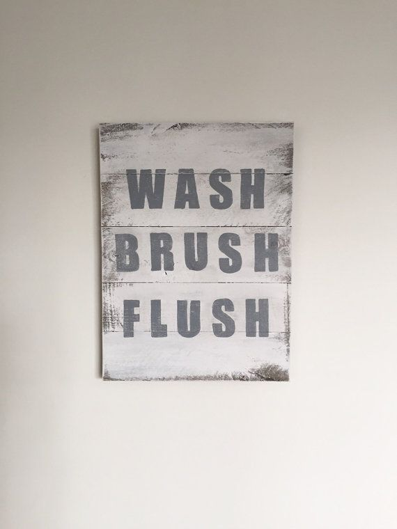 WASH BRUSH FLUSH  Handcrafted wood sign painted in a distressed/shabby gray and white. Font is painted in gray and lightly distressed. Available in two sizes: 1) 11x15 2) 16x20  *11x15 Ships via USPS Priority Mail (1-3 day delivery)  Follow us on Instagram @theclevergoose  Looking for a larger size? Try these listings:  Large in Gray Font https://www.etsy.com/listing/234149804/wash-brush-floss-flush-reclaimed-wood  Large in Black Font…