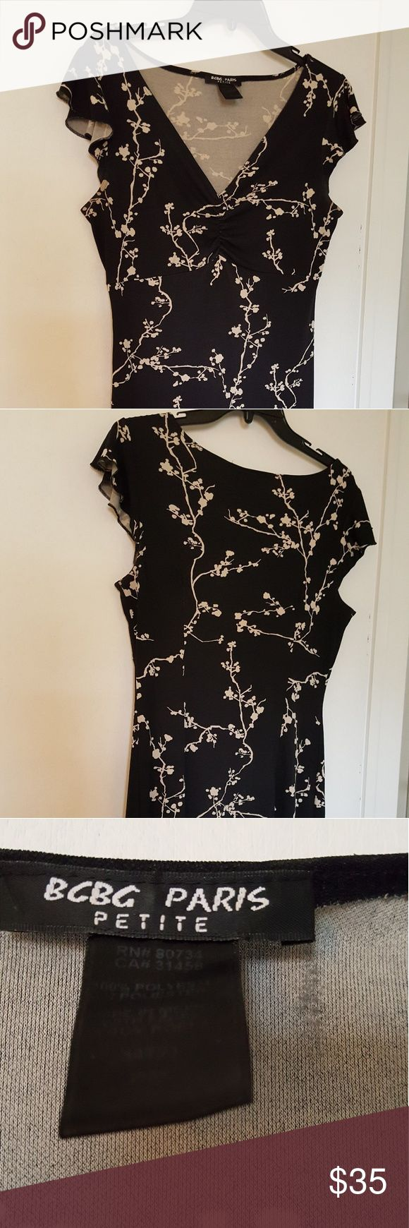 BCBG PARIS  PETITE DRESS You are looking at a BCBG petite dress  size PM. The fabric  is non wrinkle, low maintenance polyester material. 3 inch cap sleeves. Length  37 inches from back neck line. V-neck,  black and white pattern. Can be worn as a casual dress or dressed dress. BCBG Dresses