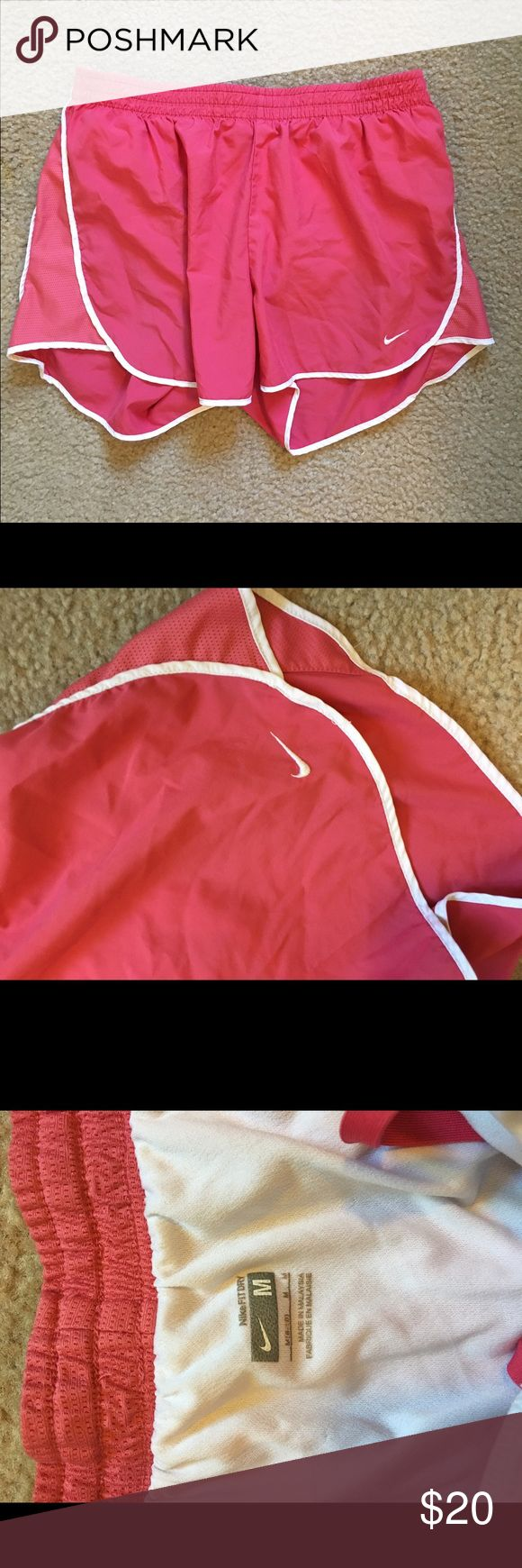 Coral Nike Shorts Size medium coral and white Nike shorts. No flaws! Open to offers; bundles discounted! Nike Shorts