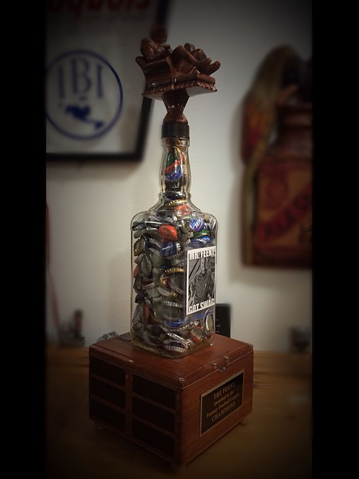 Diy fantasy football winners trophy. The Feeny. About two feet tall in height and has 24 seasons worth of engraving plates. Photo in front can be changed to the champion of that season. Long live the FEENY. Perfect for any man cave.  Work in progress