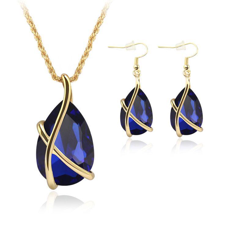 Оптовая продажа новые ювелирные изделия 18 К позолоченный крест зеленый кристалл ожерелье + мотаться ювелирные комплект женщины изумруд рубин сапфир