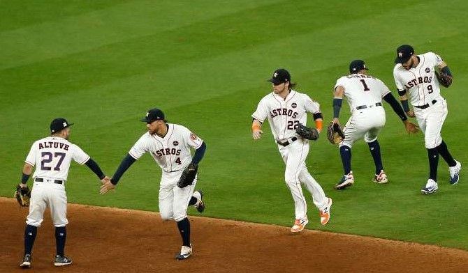 Best images of 2017 MLB playoffs  - October 21, 2017:   GEARING UP FOR GAME 7 -  The Astros celebrate after defeating the Yankees with a score of 7 to 1 in  Game 6 of the ALCS on Oct. 20 in Houston, Texas.