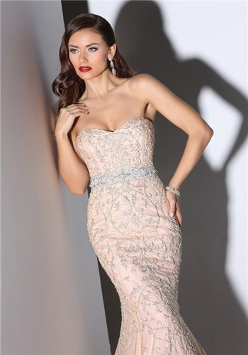 SWEETHEART NECKLINE WITH SOFT DRAPING A-LINE SKIRT EMBELLISHED WITH DRAMATIC BEADING.
