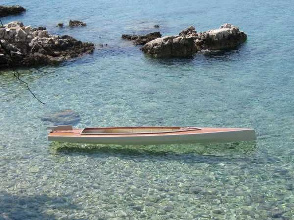 The main hull of the Trika 540 trimaran can be paddled as a large two-person kayak