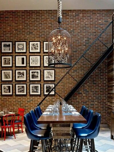 I love this! The color, brick wall, staircase, photo gallery arrangement!