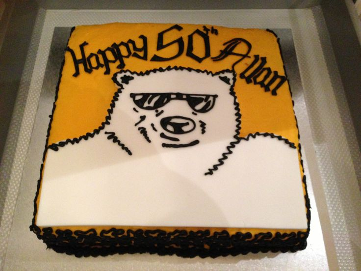 BUNDY BEAR 50th BIRTHDAY CAKE. A caramel mud cake with yellow royal icing & added vanilla, with a white fondant Bundy Bear that I let dry before I placed it on top. The lettering is in the style of the original Bundaberg Rum writing that I figured out myself.  I made this cake in 2 days as my friend forgot to order a cake for the big night.  By Christine Titheradge