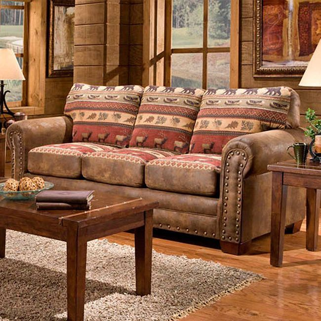 This Sierra Mountain Lodge sleeper sofa offers quality construction featuring solid wood frames and solid wood legs to ensure years of enjoyment. Lodge-inspired tapestry, coupled with beautiful nail head accents, spices up the rustic appeal of this group.