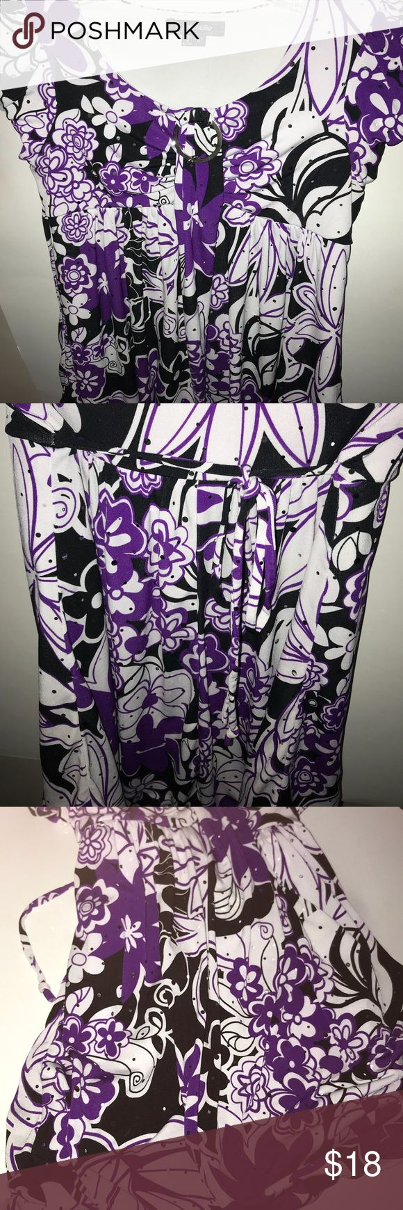 Empire sequenced blouse Gorgeous purple, white and black blouse drizzled with sequence ! A little girl's dream ! Heavy inside liner, metal hoop below neck line. Strings in back define empire waist for a flattering shape. Blouson bottom ( fabric  bundled at hem for gathered appearance with hem line absent. ) Beautiful top !! NEVER WORN! Willing to accept best offer. My Michelle Shirts & Tops Blouses