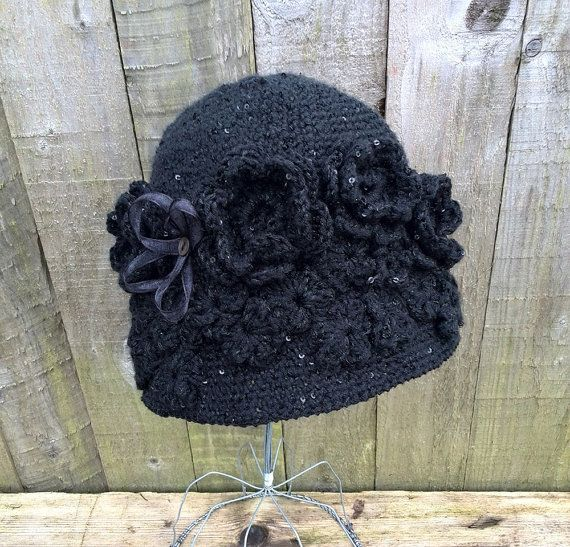 Pretty black cloche hat with applique flowers https://www.etsy.com/listing/221961087/black-cloche-hat-ladies-cloche-hat-with