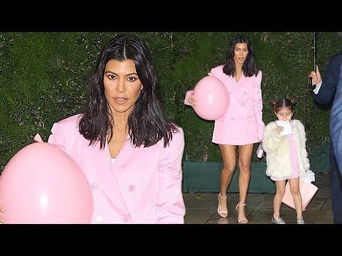 Kourtney Kardashian shows off toned legs in matching pink mini dresses w...