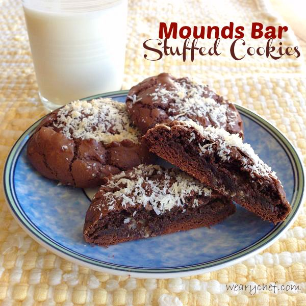 Chewy chocolate cookies are stuffed with a piece of Mounds candy bar and sprinkled with flaked coconut.