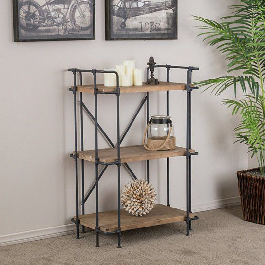 Improve your organization and showcase your favorite books and trinkets with the Brooklyn Bookcase. This shelf is constructed with brown-stained solid wood and a metal support frame, giving this shelf its industrial look. The metal cross back provides extra support and style, not to mention the shelf's size, and sleek, open design provides the right amount of storage space, without the bulk that traditional bookshelves provide. The Brooklyn Bookcase is a great solution for all you stylish...