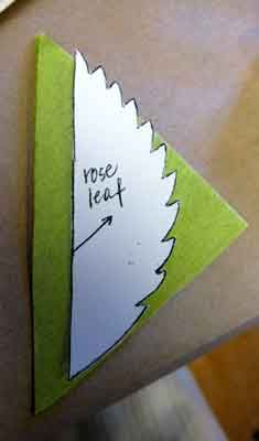 Lining up leaf template to match grain of crepe paper