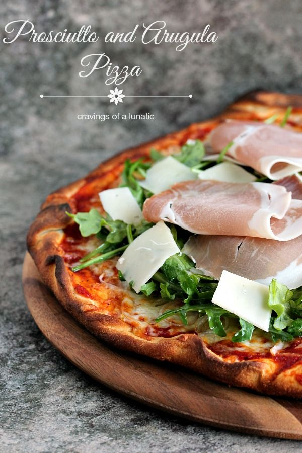 Prosciutto and Arugula Pizza from cravingsofalunatic.com- Simple to make yet full of flavour. Made in under 30 minutes, it's a winner in our house! (@CravingsLunatic)
