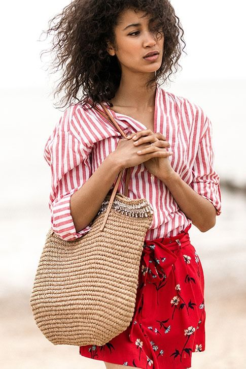 Kurt Geiger London's Diamante Raffia Bag makes the perfect everyday companion. Crafted from summer-ready tan raffia and trimmed with crystals along the top, it features light-catching silver trims and two soft leather carry straps. Bag Dimensions: 40cm H x 48cm W x 5.5cm D.
