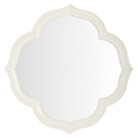 Showcasing a quatrefoil frame and white finish, this chic ...
