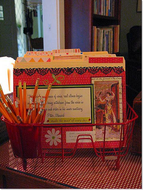 Use a colorful dish drainer to hold file folders.  Use the utensil cup to hold pencils.  This is genius.