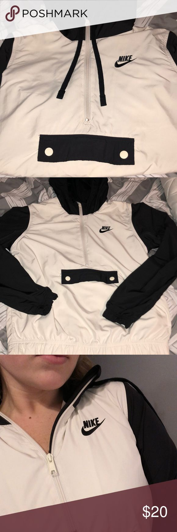 Black and white nike half zip windbreaker Worn lightly! Still in great condition. Size medium could fit a small or medium. Half zip Lined windbreaker with a pocket pouch in front. If you have any questions feel free to ask:) Nike Jackets & Coats