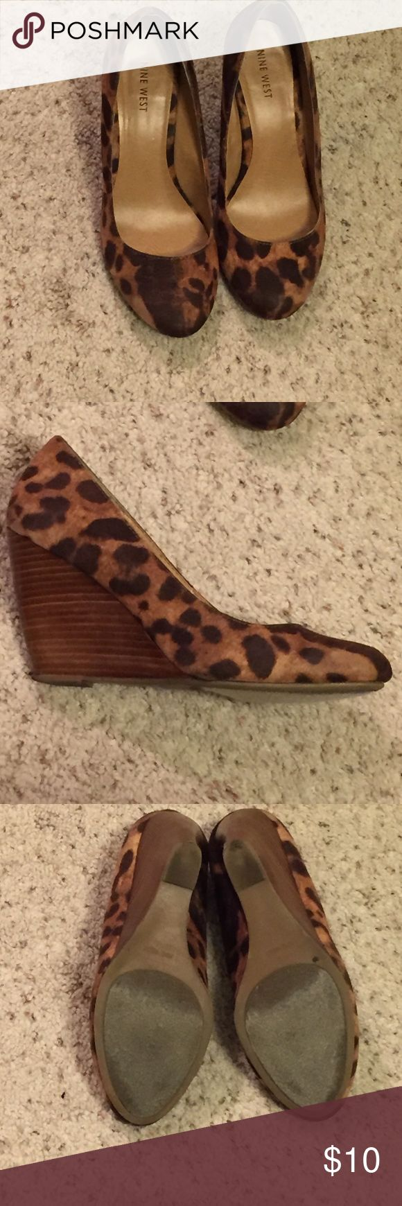 Leopard wedges Leopard print wedge heels . Gently worn, signs of wear on the heel; about 3 inches Nine West Shoes Wedges
