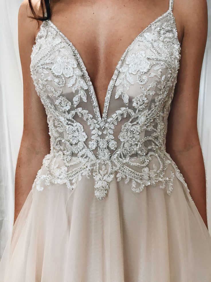 Spaghetti strap plunging v-neck lace and illusion wedding dress from David's…