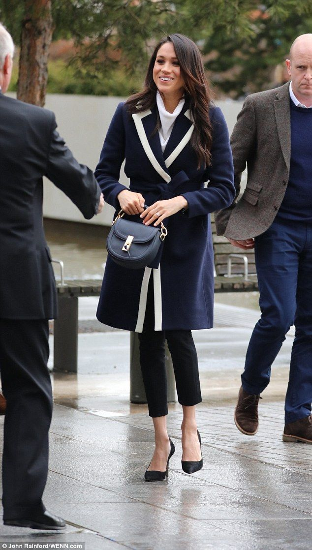 The bride-to-be looked chic in aa $298 J Crew coat, Alexander Wang trousers and an AllSai...