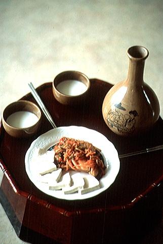 Makgeolli and dubu-kimchi(Tofu with Stir-Fried Kimchi) dubu-kimchi is sliced tofu, served with stir-fried kimchi and pork - photo
