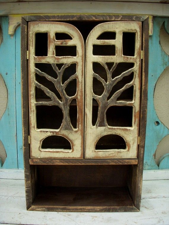 Very pretty cabinet with carved tree. When I have more money saved up I might buy one.