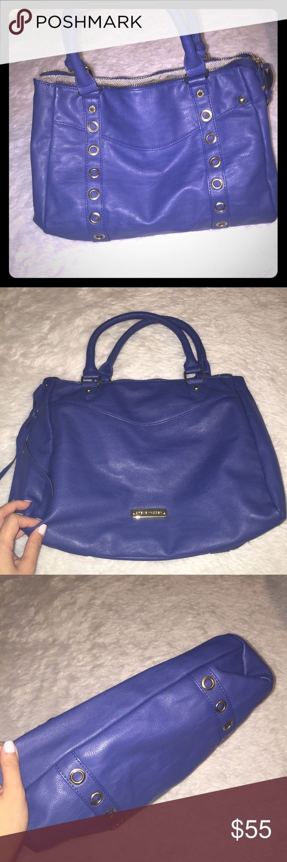 Royal blue Steve Madden purse Very pretty blue color , huge pockets and gold hard ware . East to carry around and use also terrific for going out to parties Steve Madden Bags