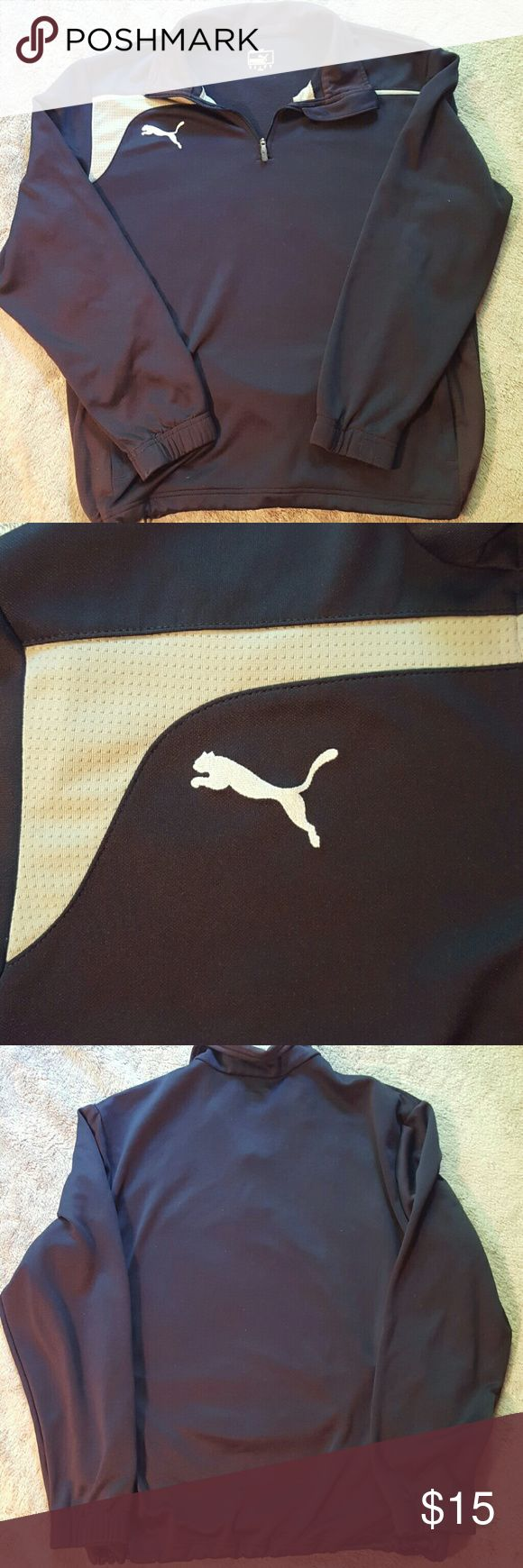 Dark blue Puma pullover Tighten at waist. Fits a small or medium, tag says M. Men's or women's. GUC Puma Shirts