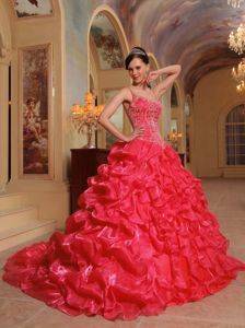 2014 Coral Red Straps Appliques Dress for a Quince with Pick-ups
