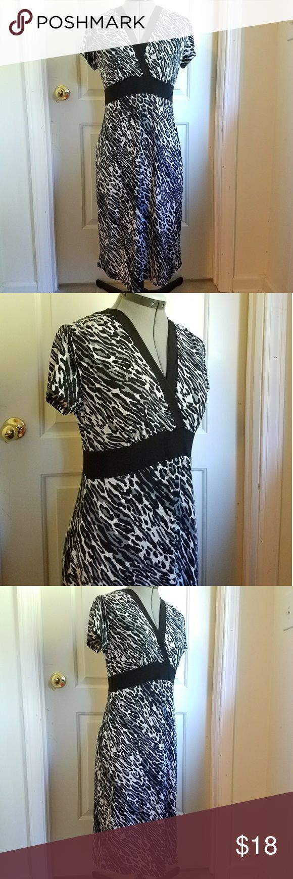 Black, White and Grey zebra print dress Very cute and flirty grey and black Zebra print dress from the Access Liz Claiborne collection. Perfect no wrinkle dress for travel or on the go.   No trades. If you see something you like, I'malways open to negotiate, and I give discounts on all bundles! Thanks for looking and I appreciate your purchase Liz Claiborne Dresses