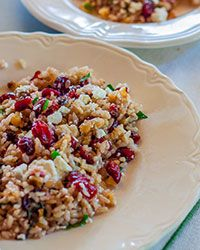 Brown Rice Salad with Cranberries, Walnuts, Mint, and Feta | This bright brown rice dish can be served warm, or chilled and served as a salad or side.