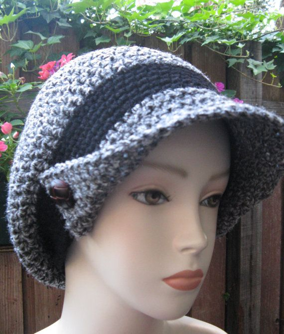 This is a grey and black newsboy style  hat made in crochet is a slouchy hat, which means that it is made to be a little puffy on the back, as you can see in the picture, this is to add more volume to the head, or to put hair inside the hat when one has a bad hair day. Its made by WoolFashion and sold for  $28.00