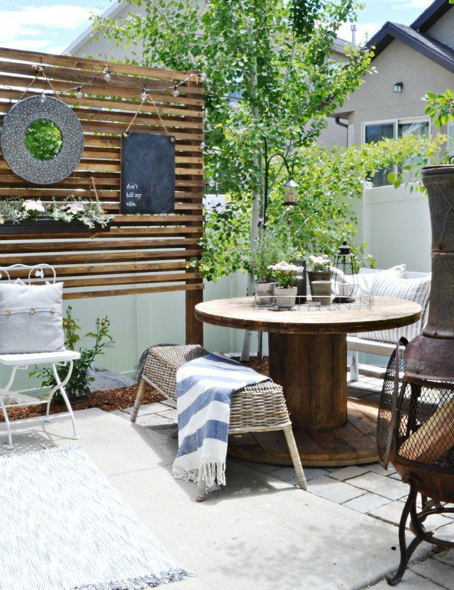Small Patio On A Budget   Simple DIY Projects and inexpensive and thrifted outdoor furniture create a beautiful, functional, small patio space. All on a tight budget.