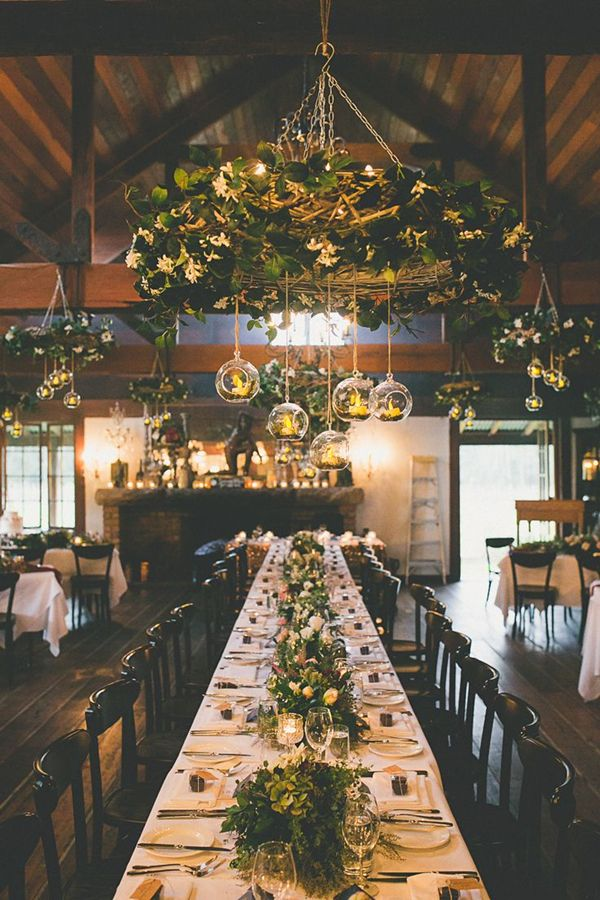 elegant winter wedding tablescape with hanging candles