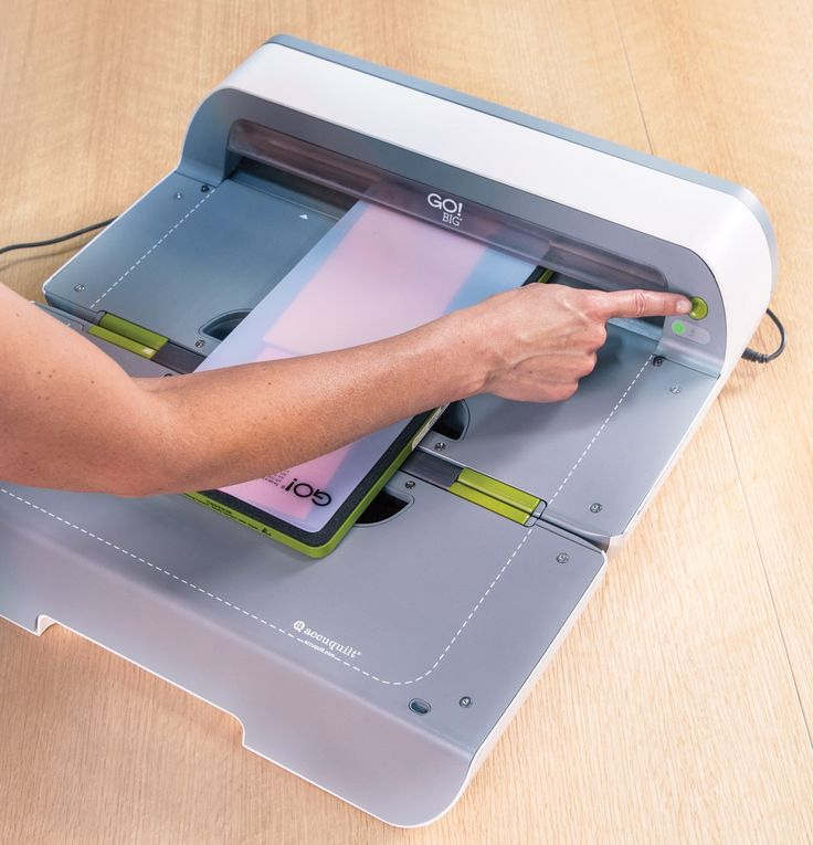"""GO! Big Electric Fabric Cutter Starter Set (55500) - shown with a 6"""" x 12"""" die ready to cut and power button."""