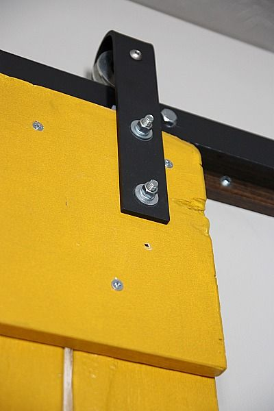 "hardware and handy ""advice"" for hanging barn door http://www.housetweaking.com/2011/02/13/diy-sliding-barn-door-part-ii/"