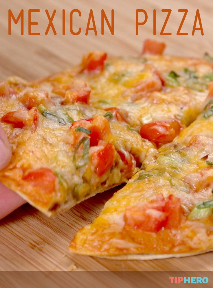 Mexican Pizza Recipe | What to try something new for dinner? How about this twist on the traditional pizza swapping in tortillas for dough and adding south of the border favorites like refried beans, red enchilada sauce, tomatoes, cheddar cheese and green onions. Perfect for Cinco de Mayo. Click for the recipe and how to video. #familydinner #dinnertime