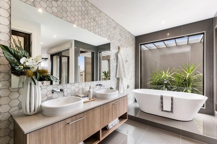 I love the hexagon wall tiles + the glass panel by the bath tub to have greenery there