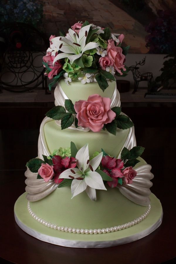 Stunning! ~ Mint and Pink with White Satin fondant draping wedding cake. ~ All the flowers are sugar and hand made. ~ all edible