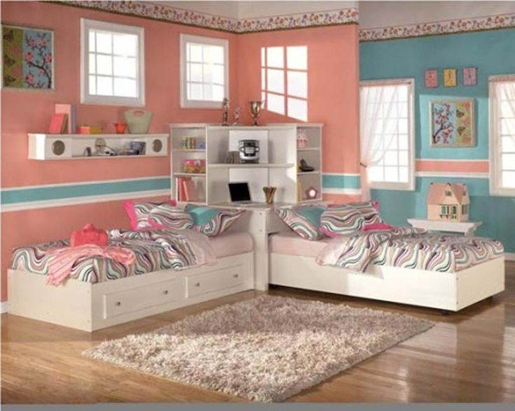 Image from http://www.alpenio.com/images/2015/04/smooth-color-twins-kids-girls-bedroom-theme-idea-brown-wooden-laminated-flooring-white-wooden-diy-storage-comfortable-twins-bed-built-in-corner-bookcase-brown-shag-rug-area-white-ceiling-paint-girls.jpg.