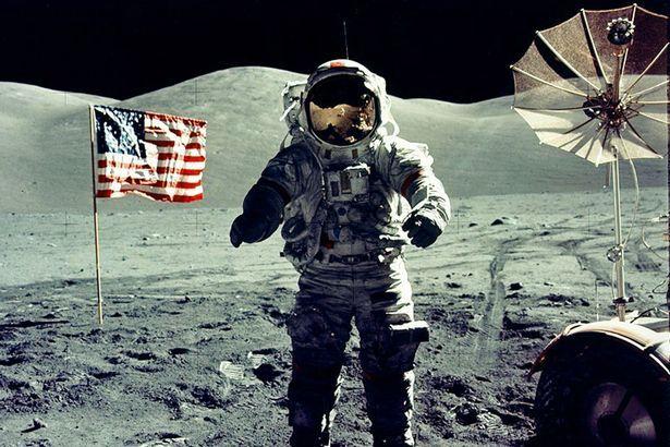 Astronaut Eugene Cernan walks toward the Lunar Roving Vehicle