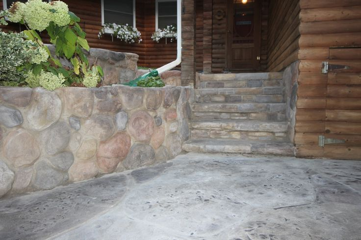 This stone like wall is Flex-C-Ment over an old concrete wall to look like stone. It was done by Hickory Dickory Decks in Grand Bend Ontario.