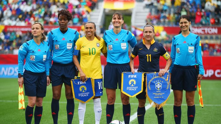 Captains Marta of Brazil (10) and Lisa De Vanna of Australia (11) line up referee Teodora Albon and fellow officials