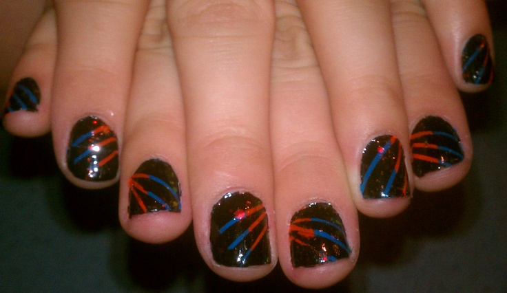 My nails. :) I messed up one finger but the rest came out great. I painted them orange and blue, put striping tape on them, painted them black, removed the tape while it was still wet, and topped it off with holographic glitter. <3