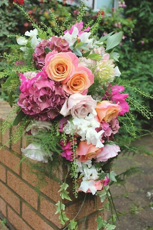 Cascade bridal bouquet of Miss piggy roses, Keira David Austin roses, sweet pea, hydrangea, quicksand roses and O'Hara roses - designed by Wild Orchid www.wildorchiddesigns.co.uk