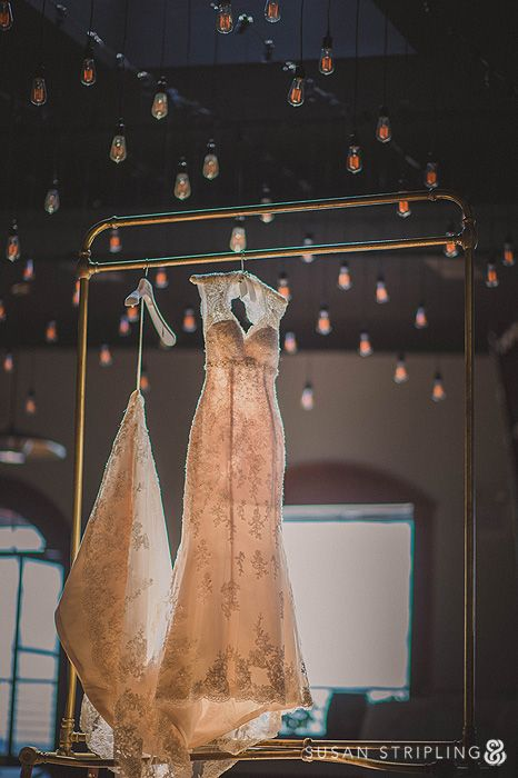 Warehouse Wedding, pendant filament bulbs and gold clothes rail