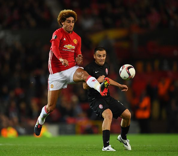 Marouane Fellaini of Manchester United competes for the ball with Zeljko Ljubenovic of Zorya Luhansk during the UEFA Europa League group A match...