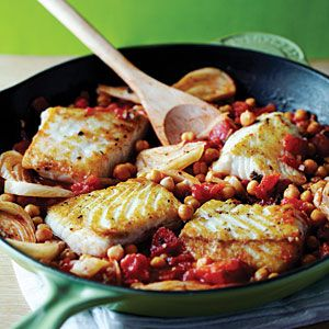 Fast & Fresh Mediterranean Greek-Style Halibut - salt and pepper halibut fillets and saute in olive oil until golden, add tablespoon of ouzo, garlic cloves, diced tomatoes, chickpeas, and oregano