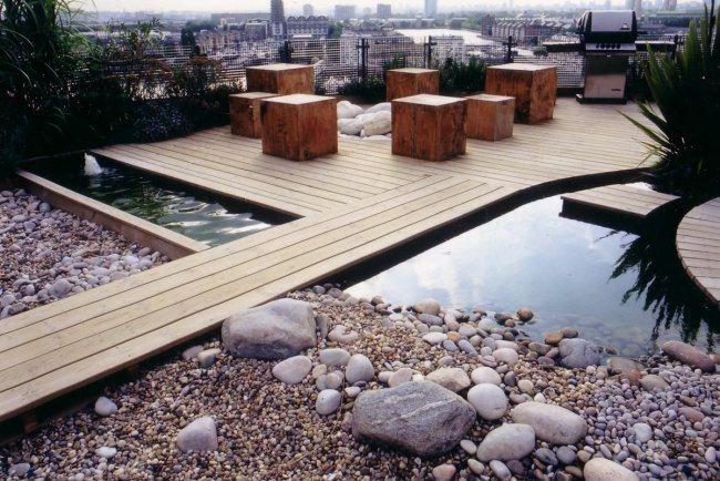 Dachterrasse gestaltung kies steine holzdeck massivholz for Dachterrassen gestaltungsideen